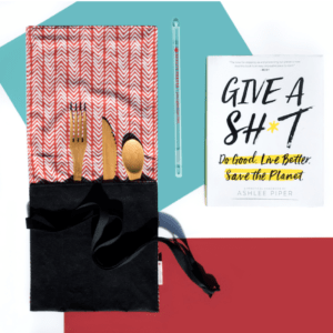 picture of a reusable straw and utensil set in a carry pouch and a book called Give A Shit about how to live eco-friendly
