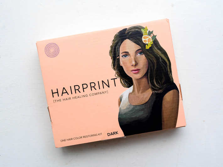 A pink Hairprint box sits on a white table.