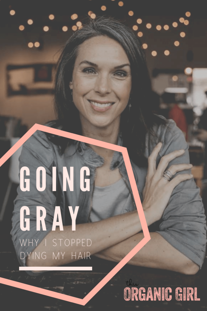 """An image of a woman with graying hair smiling. Overlaid text reading """"Going Gray, Why I stopped dying my hair."""""""