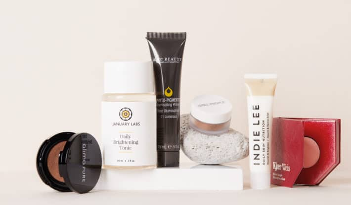 several high-end clean beauty products flat lay