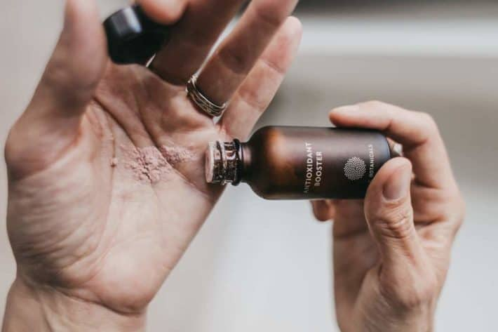 Lisa shaking out the true botanicals antioxidant booster into her hand.