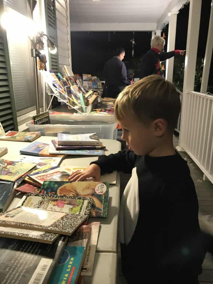 My 4-year-old shopping books on Halloween at a neighbors