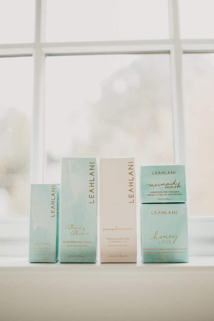 5 leahlani organic skincare products lined up on a shelf