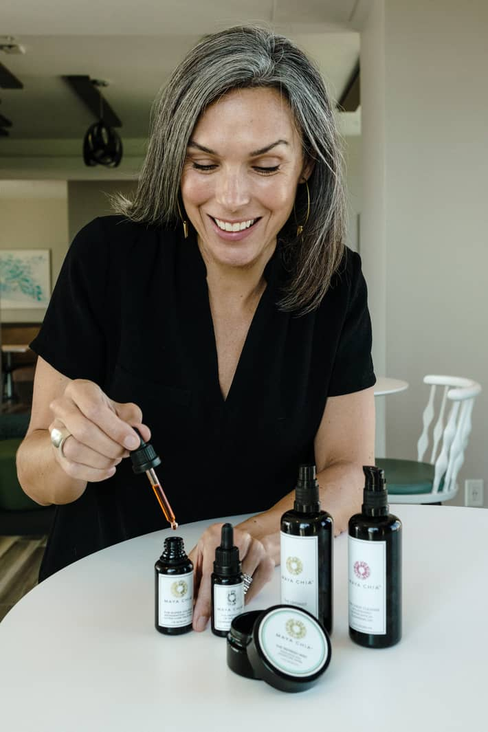 showing 5 maya chia products and the deep red color of the face oil in the dropper