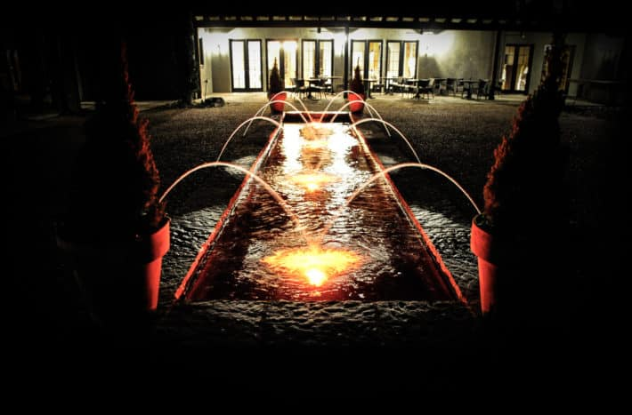 HOTEL DOMESTIQUE courtyard at night