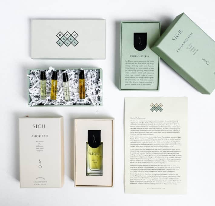 Boxwalla unboxing featuring Sigil nontoxic fragrances showing two large bottles and 4 sample sizes with all the packaging