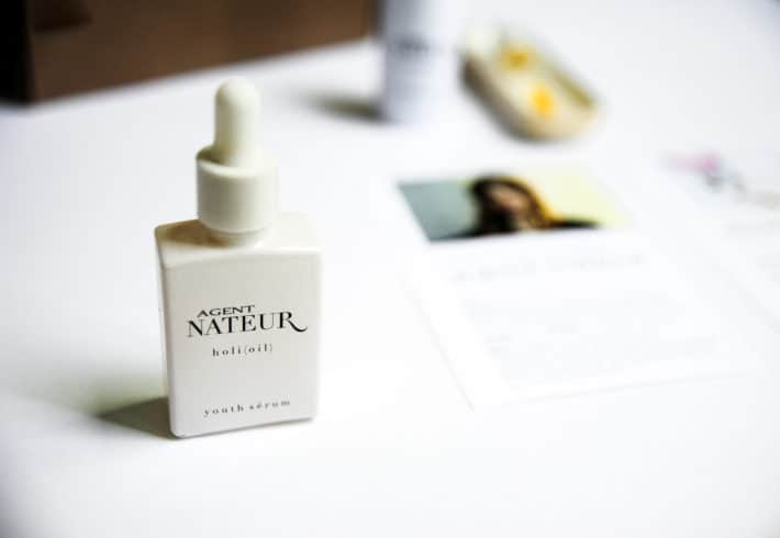 A close up of the Agent Nateur Holi Oil with the May Detox box blurred in the background