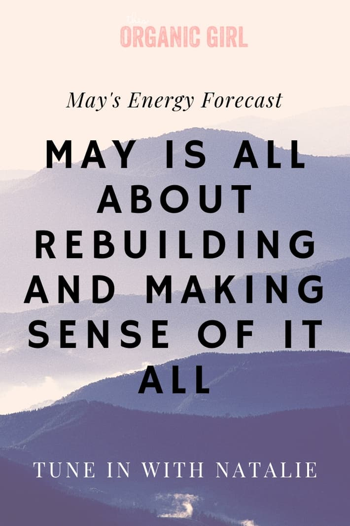 Purple mountains in the back with black lettering over saying May is all about rebuilding and making sense of it all