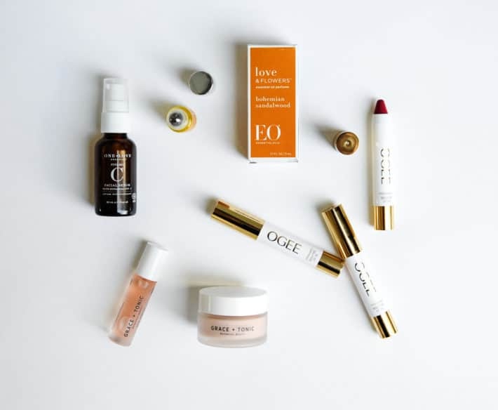 several clean beauty products displayed open on a white background