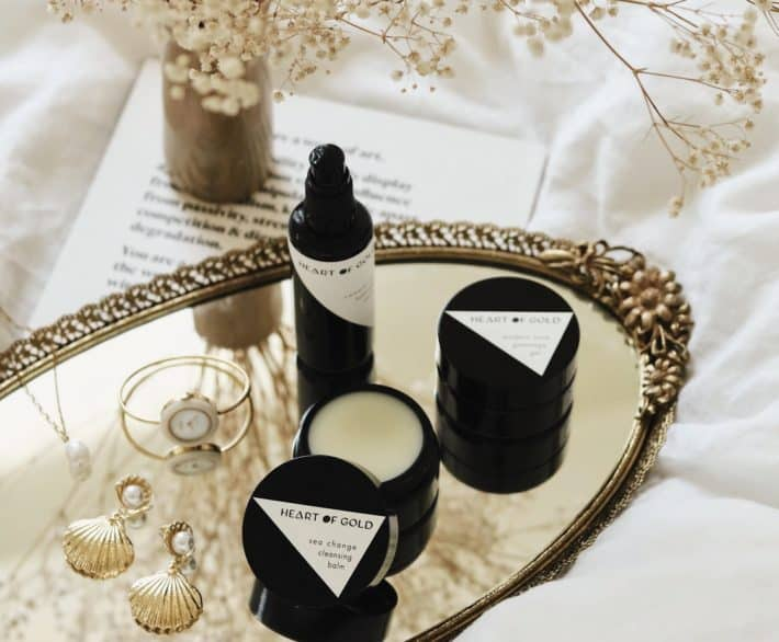 Heart of Gold skincare on a gold tray featured in the August Boxwalla