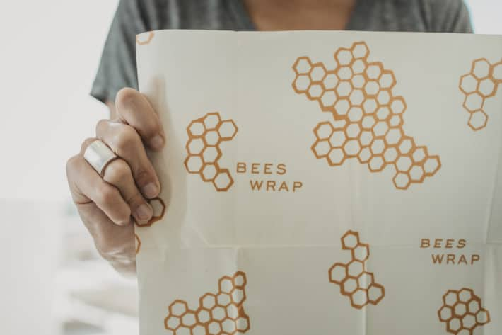 holding Bee's Wrap up to show honeycomb pattern and size