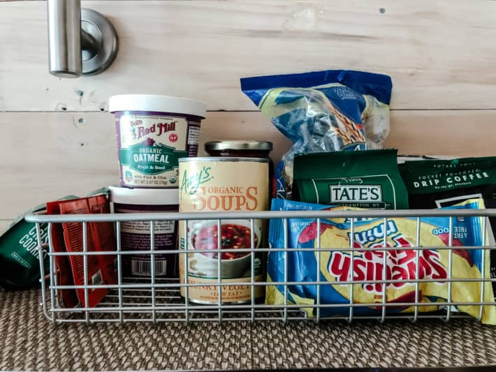 a basket of provisions including Swedish Fish, organic soups and organic oatmeal and more