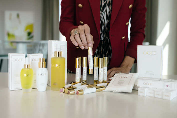 reaching for an OGEE Sculpted Lip Oil among the OGEE full line