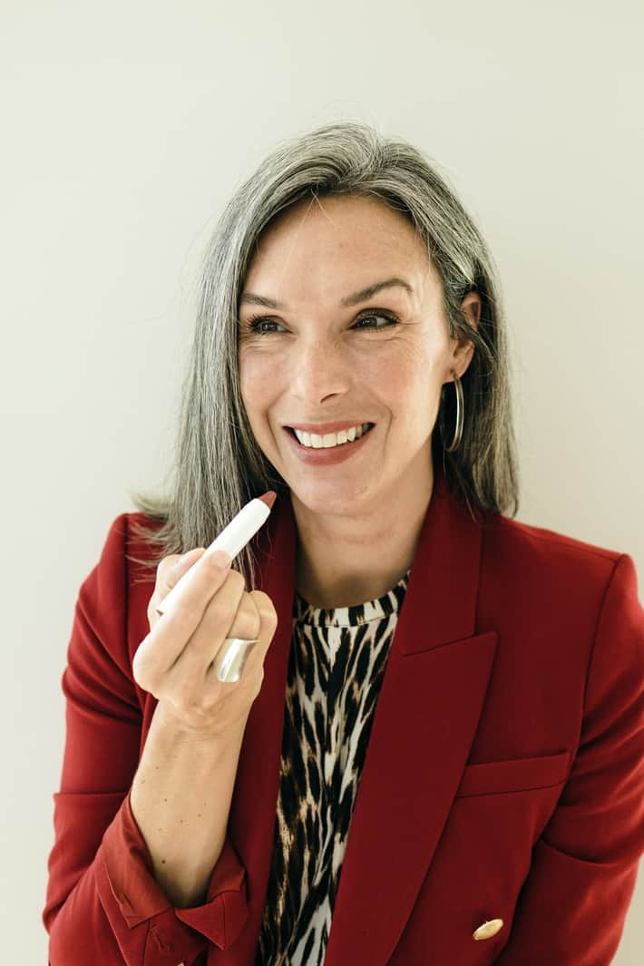 Lisa applies a French nude tinted lip oil.