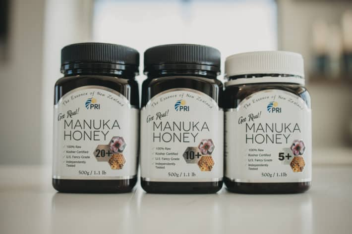 three bottles of PRI Manuka honey