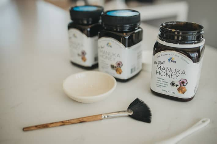 manuka honey, mask brush and bowl for a DIY honey mask