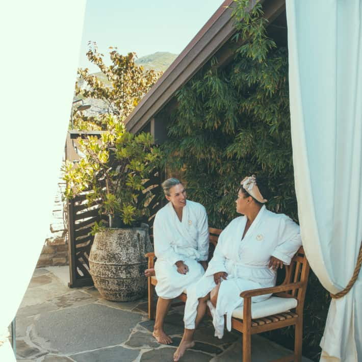girlfriends sitting outside at the spa at the ranch at laguna beach