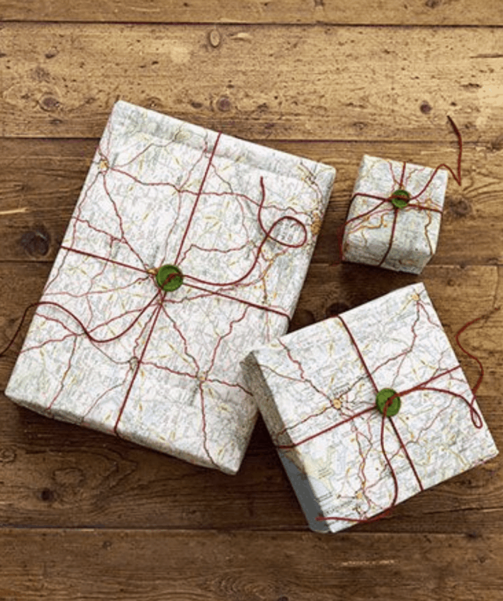 three gifts wrapped in old maps