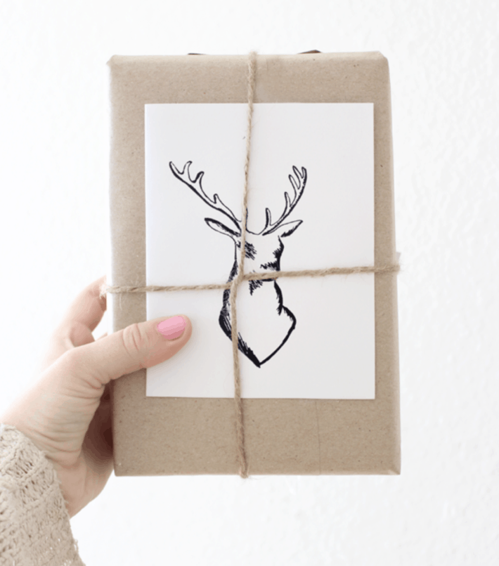 sketch of an elk or deer centered on a brown paper wrapped gift
