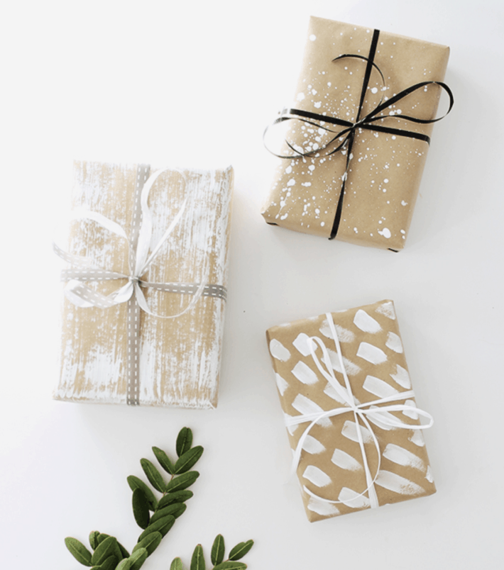 brown paper painted with white brush strokes in a pattern