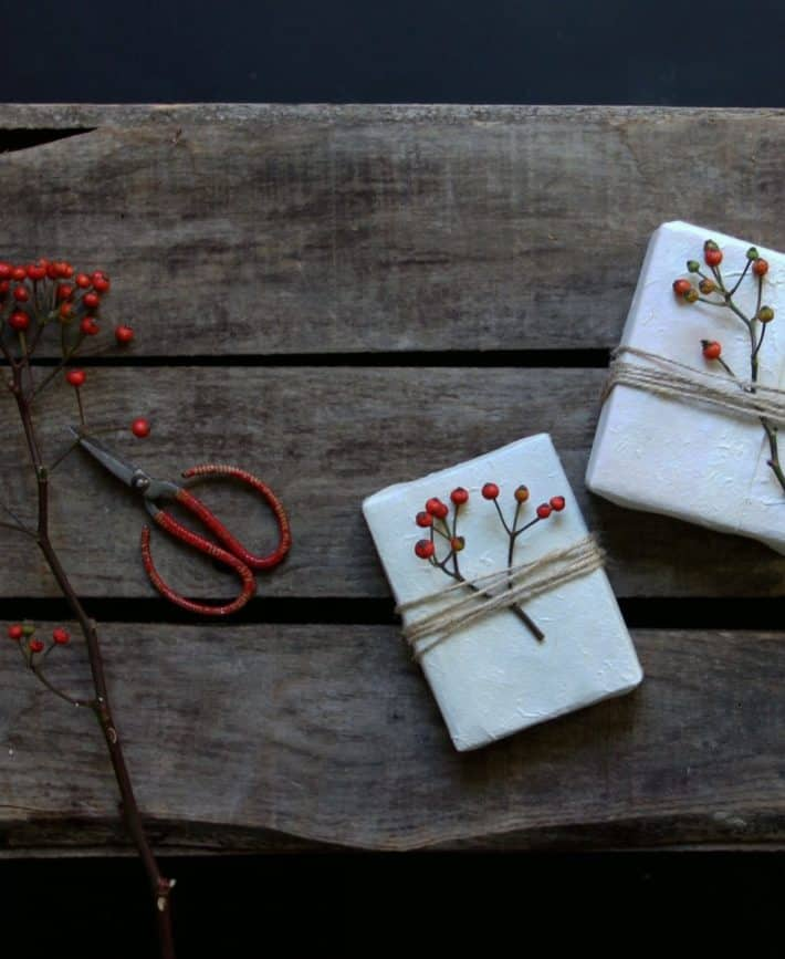 recycled handmade biodegradable white paper with twine and berries