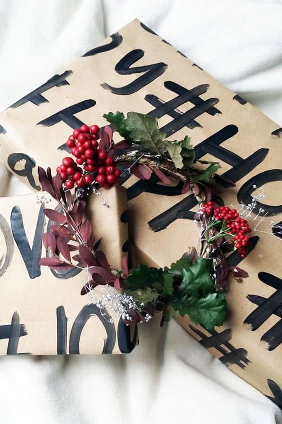 painted hashtags on brown paper with berries and greenery to finish