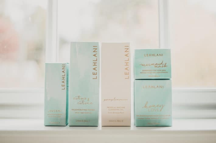 leahlani products lined up on a sill