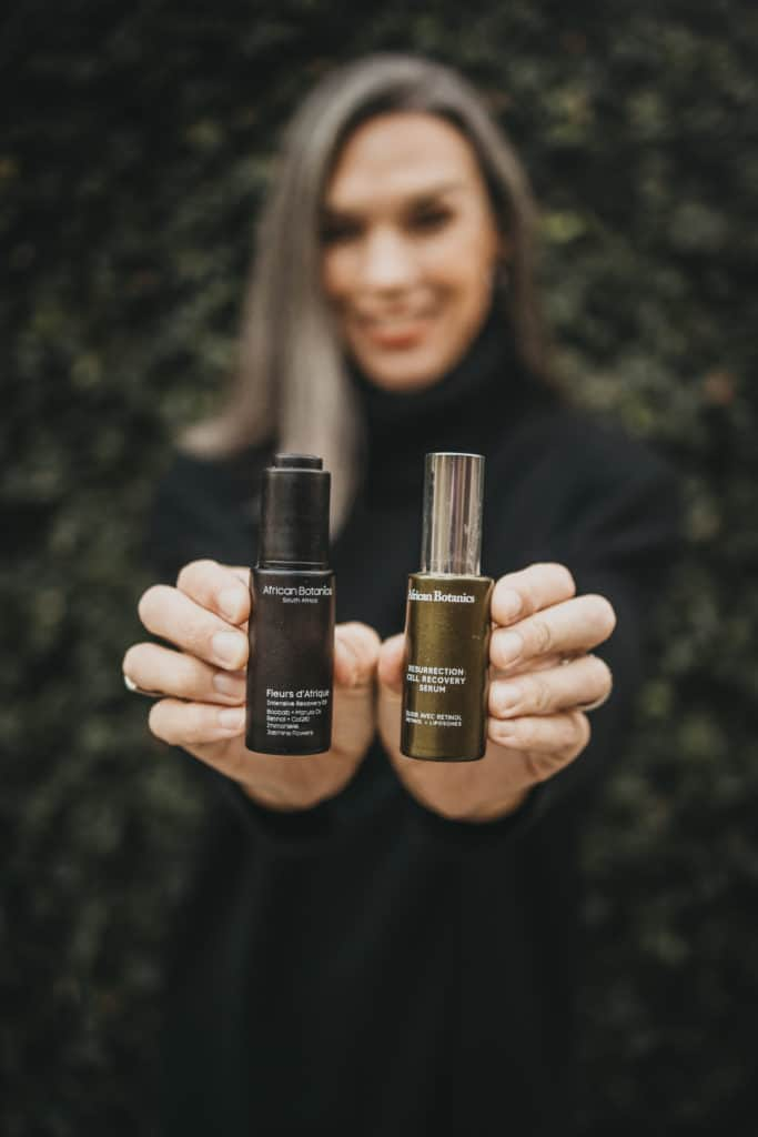 holding two african botanics products