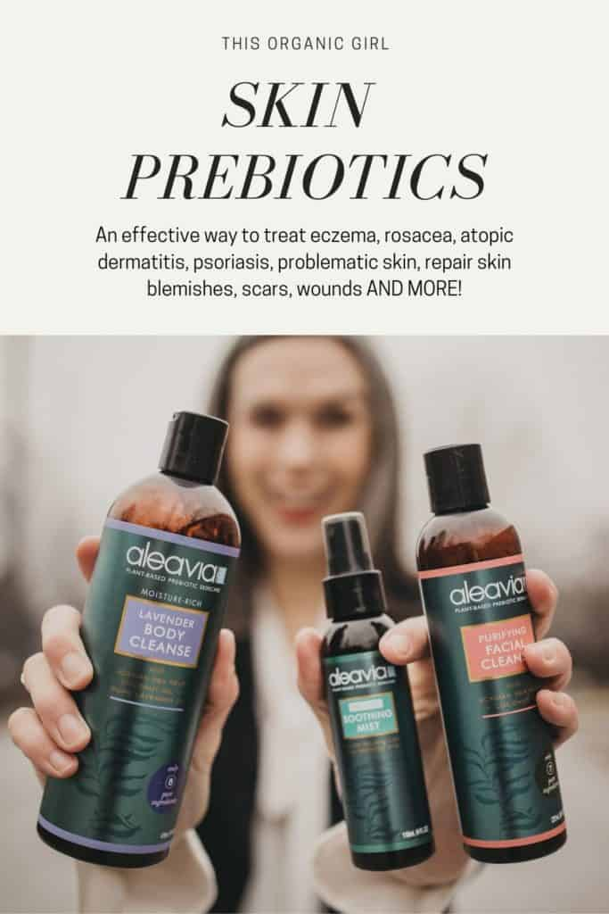 holding up 3 bottles of Aleavia prebiotic skincare