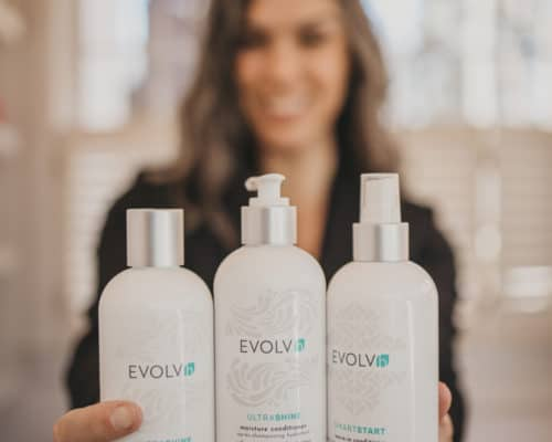 me holding three EVOLVh products in my hands