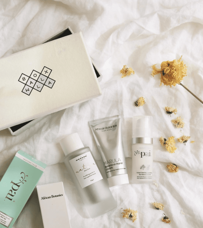 three products laying on a bed with an open boxwalla box
