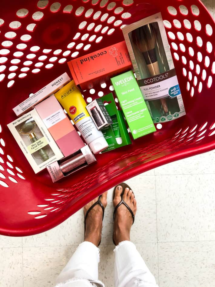 a red target basket full of beauty products