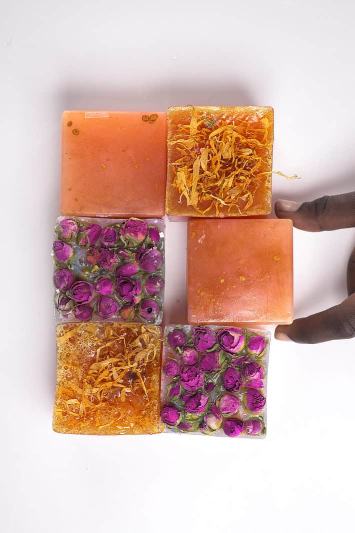 six samples of IYOBA handmade soaps laid out on white surface