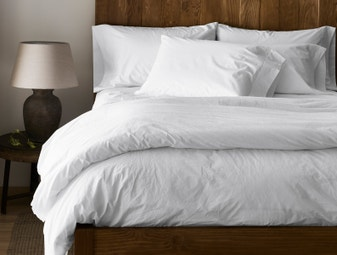 organic white bedsheets and duvet on a bed