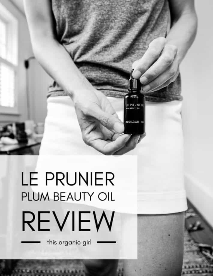 a black and white of me holding a bottle of Le Prunier