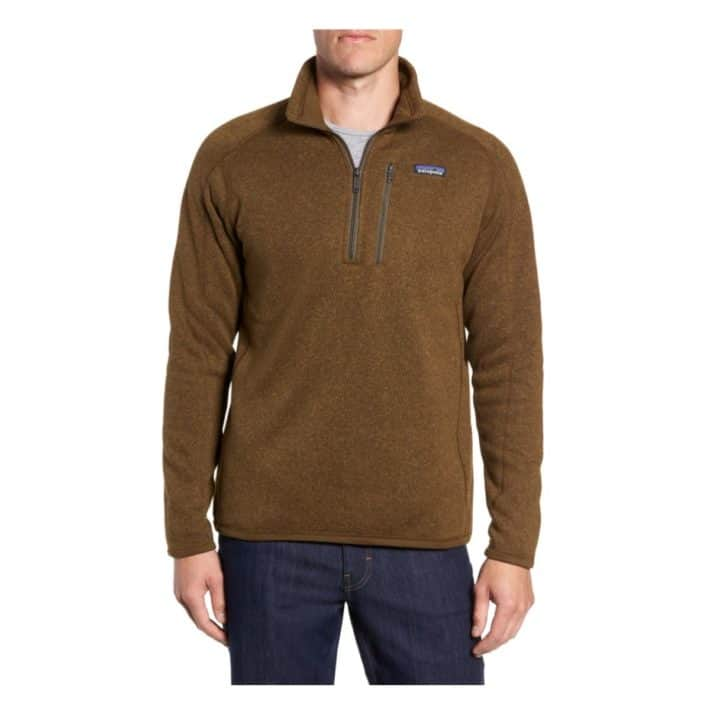 man wearing brown pullover sweater and jeans