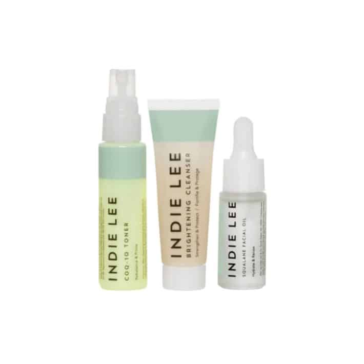 three bottles of Indie Lee beauty products