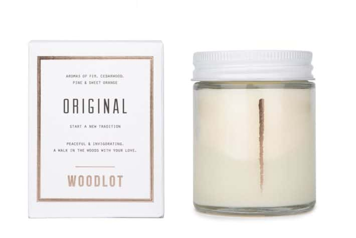 Woodlot Candle placed next to its packaging