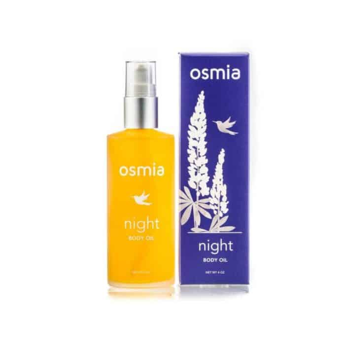 bottle of OSMIA Night Body Oil next to the box it's sold in