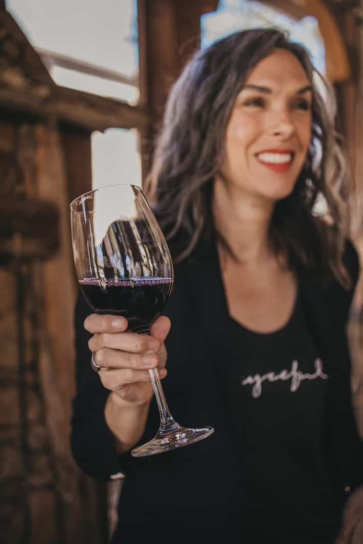 lisa holding a glass of dry farm wines red