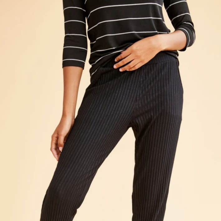 woman wearing black striped shirt and ribbed joggers
