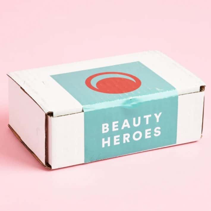 white box with Beauty Heroes logo on it in front of a pink background