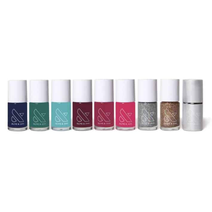 nine bottles of Olive + June nail polish in various colors