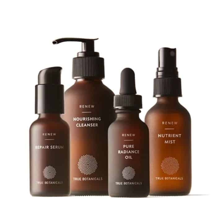 four bottles of True Botanicals in the Renew Line including repair serum, nourishing cleanser, pure radiance oil, and nutrient mist