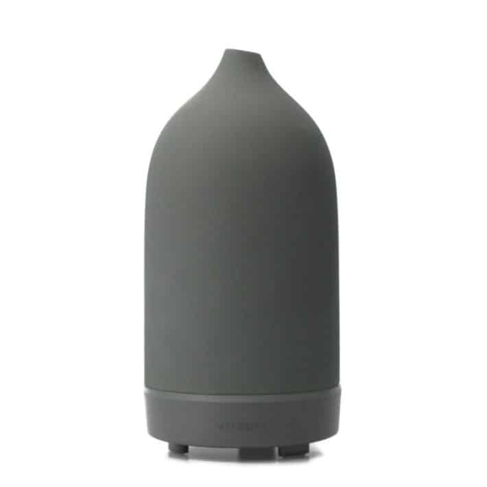 details of a VITRUVI Porcelain Essential Oil Diffuser show its size and gray color