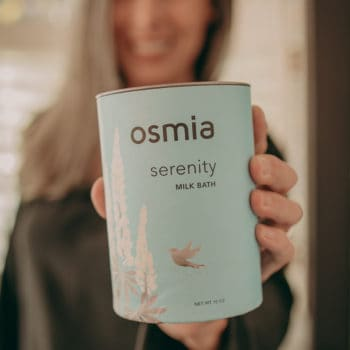 Lisa holding container of Osmia milk bath