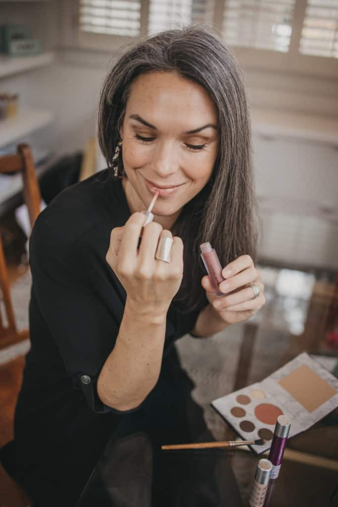 applying fitglow beauty's lip colour serum in AU