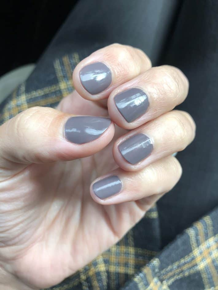 Lisa's hand with Sally Hansen nail polish soothing slate shade