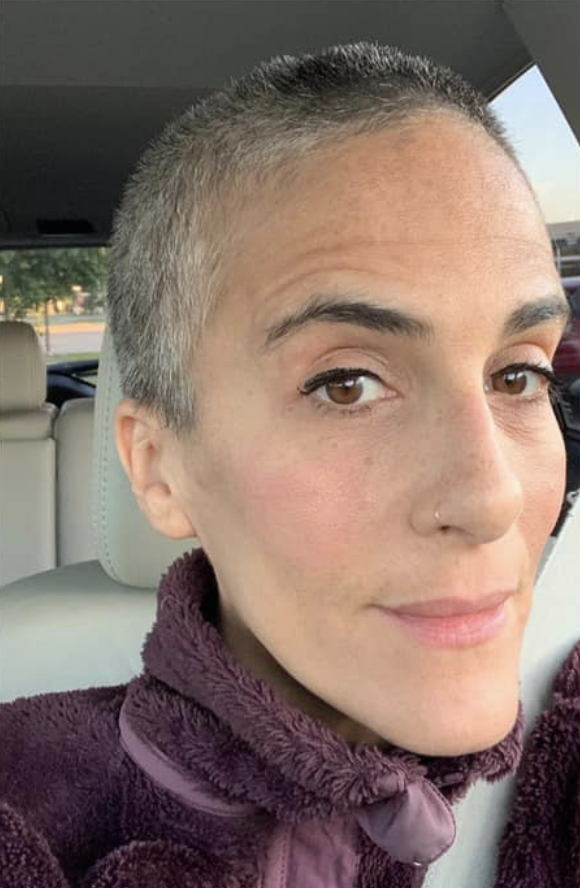 woman with gray hair and shaved hair