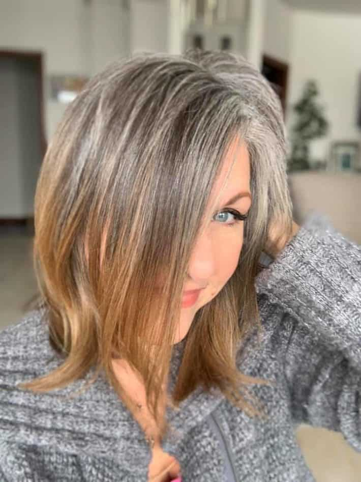 Woman with gray hair and highlights